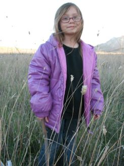 My daughter, Emily, standing among perennial grasses at the previously grazed site.